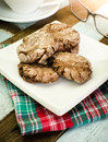Chocolate with almond slices cookies in powdered sugar close up Royalty Free Stock Image