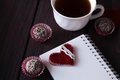Chocolate balls and notebook with bookmark Royalty Free Stock Photo