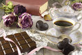 Chocolate bar with coffe cup vintage still life fancy cakes and coffee on wood Stock Image