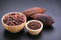 Chocolate bar and dried cocoa pod, cocoa nibs in wooden bowl on