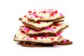 Chocolate bark with candy heart sprinkles stacked over white and dark shaped Stock Image
