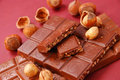 Chocolate bars with hazelnuts Royalty Free Stock Images