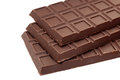 Chocolate bars three on white background shallow depth of field closeup Stock Images