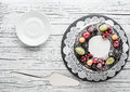 chocolate berry cake on plate over white wooden background Royalty Free Stock Photo