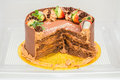 Chocolate birthday cake, partly eaten in a refigerator. Royalty Free Stock Photo