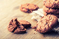 Chocolate biscuit cookies. Chocolate cookies on white linen napkin on wooden table Royalty Free Stock Photo