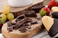 Chocolate, biscuits, grapes and strawberrie Stock Images