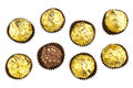 Chocolate bonbons photograph of several hazelnut balls wrapped in gold paper on a white background Royalty Free Stock Photography