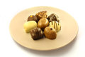 Chocolate bonbons on plate Royalty Free Stock Photography