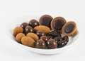 Chocolate bonbons on a white plate isolated Stock Photography