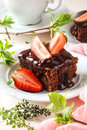 Chocolate brownie cake with fresh strawberries Royalty Free Stock Photo