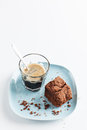 Chocolate brownie on plate served with espresso shot slice of delicious homemade pale blue glass of coffee taken a white Stock Image