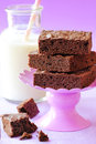Chocolate brownies delicious homemade double on purple stand with milk at the background Stock Image