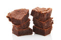 Chocolate brownies stacked and isolated over white background Stock Image