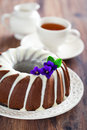 Chocolate bundt cake with icing selective focus Stock Photo
