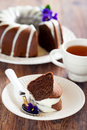 Chocolate bundt cake with icing selective focus Stock Image