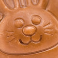 Chocolate bunny macro shot of a ornament on egg Stock Photo