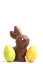 Chocolate bunny two easter eggs white background Royalty Free Stock Photography