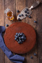 Chocolate cake with cacao powder and blueberries