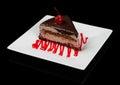 Chocolate cake with cherry glazed one on top Stock Photos