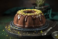 Chocolate cake with chocolate glaze and pistachios Royalty Free Stock Photo