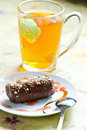 Chocolate cake and cup of green tea Stock Photo