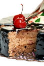 Chocolate cake decorated with cherries. Royalty Free Stock Photography