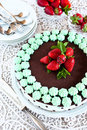 Chocolate cake with mint cream and strawberries fresh Stock Photo