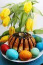 Chocolate cake passover holiday still life eggs flowers and Stock Photos