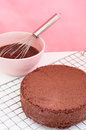 Chocolate cake preparation on sieve and batter with whisk Stock Photos