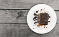 Chocolate cake slice with nut on plate on wooden table, top view Royalty Free Stock Photo