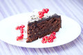 Chocolate cake a slice of on a plate Royalty Free Stock Images