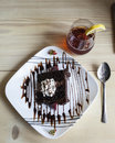Chocolate cake with whipped cream and iced tea Stock Photo