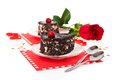 Chocolate cakes and red rose in Valentine's day Royalty Free Stock Photo