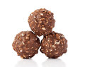 Chocolate candies with nuts on white background cutout Stock Photography