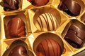 Chocolate candy variety in a gold foiled box Stock Photo