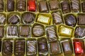 Chocolate candys with icing in golden box Royalty Free Stock Photos