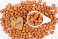 Chocolate caramel popcorn in white cup and wooden heart. Royalty Free Stock Photo