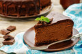 Chocolate cheesecake with chocolate glaze on white wood background tinting selective focus Royalty Free Stock Photos
