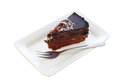 Chocolate cheesecake a slice of cake on a plate with fork isolated on a white background clipping path provided Stock Photo