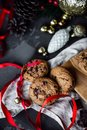 Chocolate chip cookies with red ribbon. Freshly baked on rustic dark concrete table. Selective Focus. Copy space