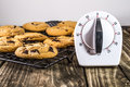 Chocolate Chip Cookies with Timer on Cooling Rack Royalty Free Stock Photo