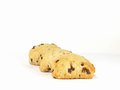 Chocolate chip scones three spongy on white background Stock Photos