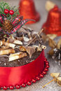 Chocolate christmas cake portrait with twirl topping and red rib Royalty Free Stock Photo