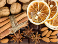 Chocolate, cinnamon sticks, anise stars, nuts Royalty Free Stock Photos