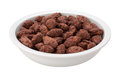 Chocolate coated almonds in a bowl isolated on white with a clipping path Royalty Free Stock Image