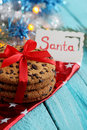 Chocolate cookies with a card that says Santa Royalty Free Stock Photo