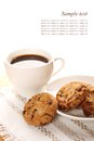 Chocolate cookies and a cup of coffee close up round biscuits Stock Photos