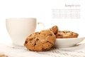 Chocolate cookies and a cup of coffee close up round biscuits Royalty Free Stock Images