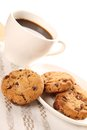 Chocolate cookies and a cup of coffee close up round biscuits Stock Images
